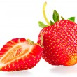 Whole strawberry and half on white background — Stock Photo