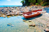 Scenic seascape with old boat — Stock Photo