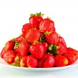 Pile of garden strawberry on a plate isolated — Stock Photo #36356257