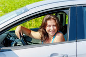 Portrait of a cheerful woman driving a car — Stock Photo