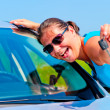 Happy woman showing keys of her new car — Stock Photo