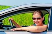 Woman in sunglasses driving a modern car — Stock Photo
