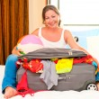 Stock Photo: Beautiful womand collected suitcase