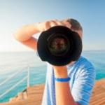 Beach photographer with a large camera closeup — Stock Photo #37303601