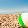 Beach ball on the beach by the sea — Stock Photo