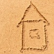 House drawing on the wet sand at the sea — Stock Photo