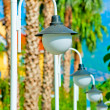 Row of white streetlights and palm trees — Stock Photo