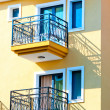 Two small balconies on the yellow house — Stock Photo