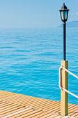 Lighting pole on a wooden pier — Stock Photo