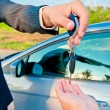 Stock Photo: Handing over keys of new car buyer