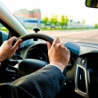 Постер, плакат: Man holds the steering wheel firmly with both hands