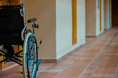Empty wheelchair in the hallway for the disabled — Stock Photo