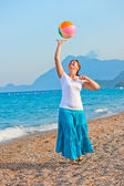 Beautiful girl playing on the beach ball — Stock Photo