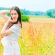 Stock Photo: Beautiful womposing in field of flowers