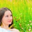 Stock Photo: Portrait of girl in green grass and clover