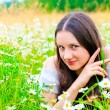 Stock Photo: Playful look girls in camomile field