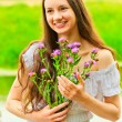 Beautiful smiling happy girl with a bouquet — Stock Photo