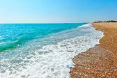 Foam aqua and sandy beach — Stock Photo