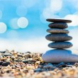 Pebble beach and gray spa stones in the form of a tower — Stock Photo #38336285