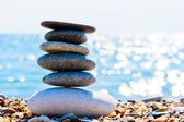 Oval pile of stones on the beach — Stock Photo
