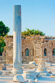 Stone pillar on the background of the ancient ruined city — Stock Photo