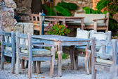 Gray wooden furniture in an outdoor restaurant — Zdjęcie stockowe