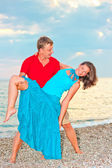Couple embracing and resting on the beach — Stockfoto