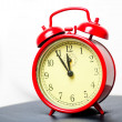 Red alarm clock in a retro style shot in a studio — Stock Photo