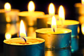 Bright flame burning small candles — Stok fotoğraf