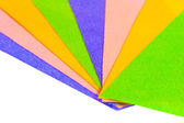 Bladen van gekleurd papier gelegd heldere ventilator — Stockfoto