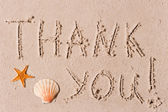 Word of thank you to the wet sand or seashells — Stok fotoğraf
