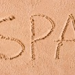 Spa is written in the sand on the beach in large letters — Stock Photo #40026263