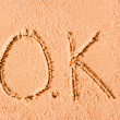 OK written on wet sand at sea — Stock Photo #40026293