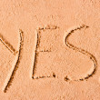 YES written on wet sand at sea — Stock Photo #40026347