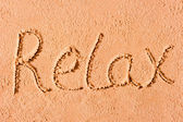 Relax written on wet sand at the sea — Foto de Stock