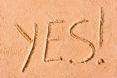 YES written on wet sand at the sea — Foto de Stock