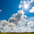 Stock Photo: Bright rays of sun over yellowed field