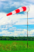 Windsock at the airport shows wind direction — Stock Photo