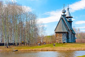 Beautiful rural landscape with wooden church — Stock Photo