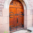 Wooden medieval gate in the stone wall of the castle — Stock Photo #41501045