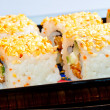 Rolls with eel and sesame seeds on a black dish — Stock Photo #41858245