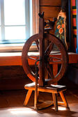 Wooden spinning installation in a cottage — Stock Photo