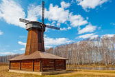 Beautiful wooden windmill in a field in spring — Stock Photo
