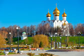 White-stone cathedral with golden domes on the hill — Stock Photo