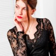 Woman in lace black dress looking to the side — Stock Photo