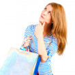Portrait of a beautiful woman with purchases ponder — Stock Photo #42574737