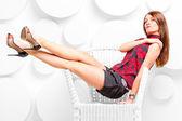 Beautiful girl in the studio posing in chair — Stock Photo
