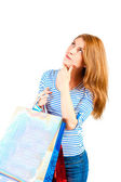 Portrait of a beautiful woman with purchases ponder — Stock Photo
