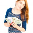 Beautiful smiling woman holding a fan of money — Stock Photo