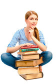 Brunette with a stack of books to learn the subject — Stock Photo